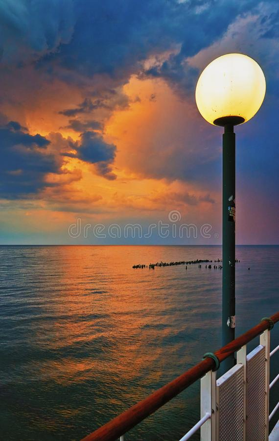 Lantern in the evening on the pier in Heringsdorf with sunset in the background. Baltic Sea island Usedom. Germany royalty free stock photos