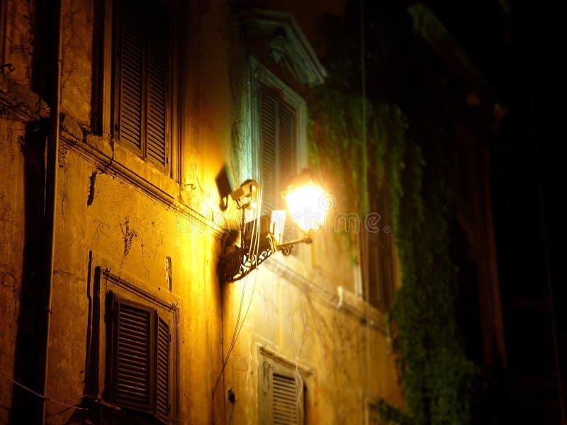 Lantern on facade of house in Rome stock photos