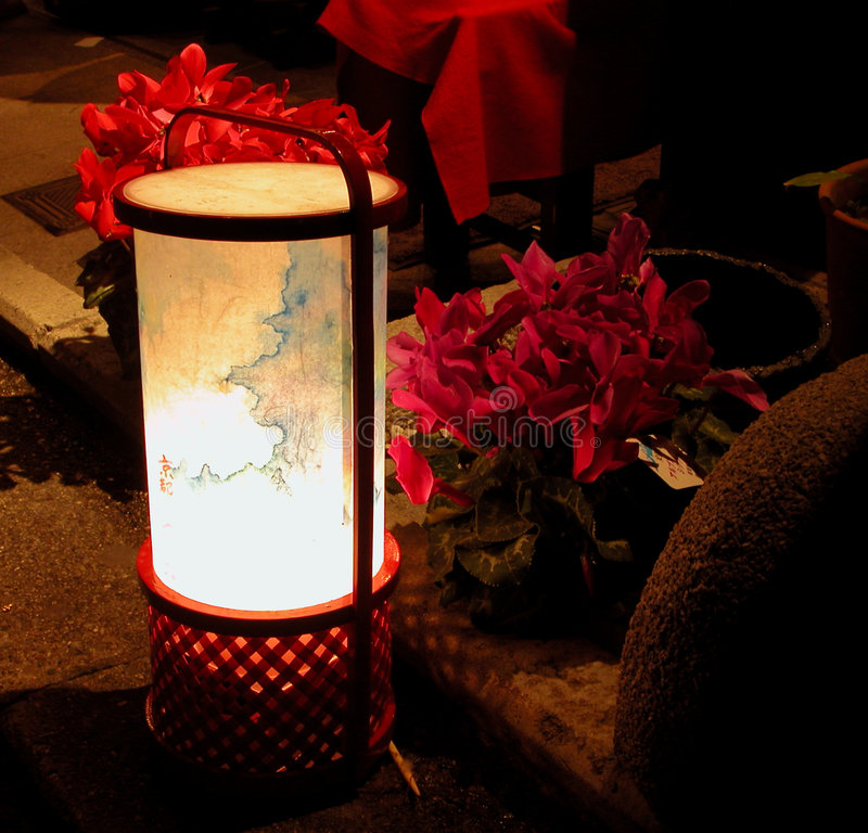 Lantern and flowers in the nig royalty free stock image