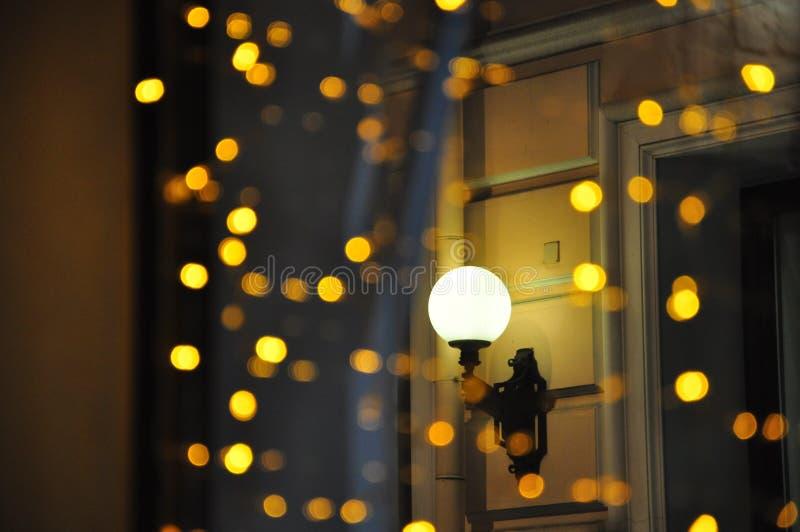 Lantern through garlands stock images