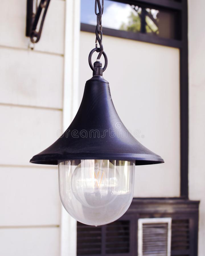 Lantern with a glass lamp hanging on a chain stock photo