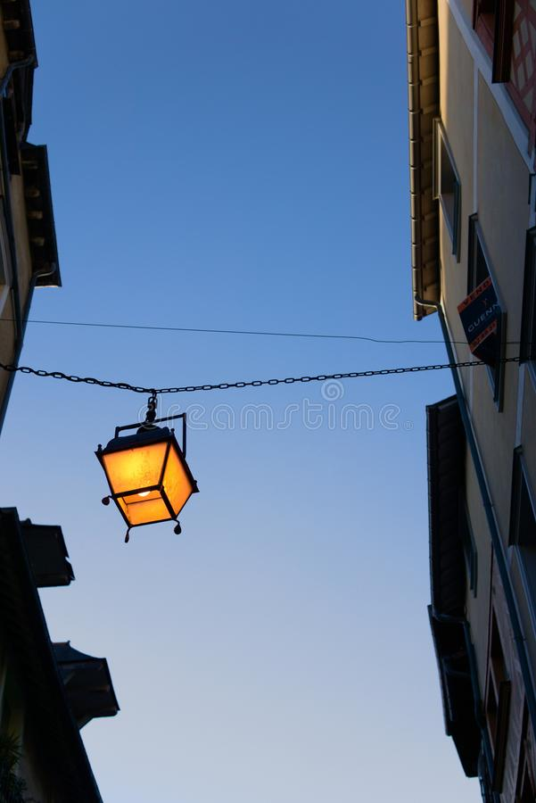 Lantern hanging in alley vertical europe stock images