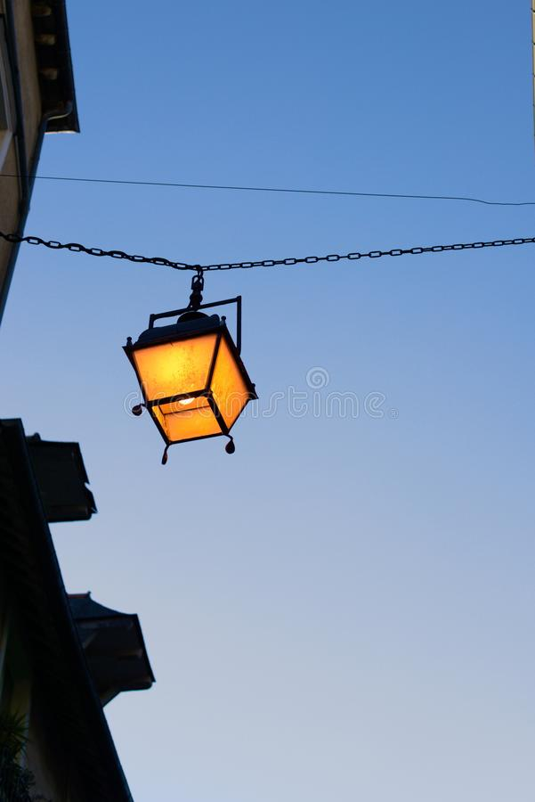 Lantern hanging european alley royalty free stock image