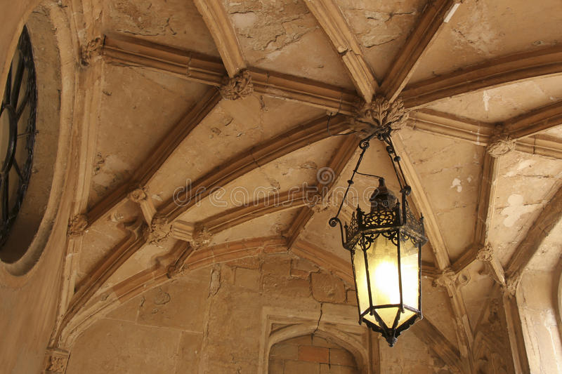 Lantern Hanging from a Stone Ceiling royalty free stock photography