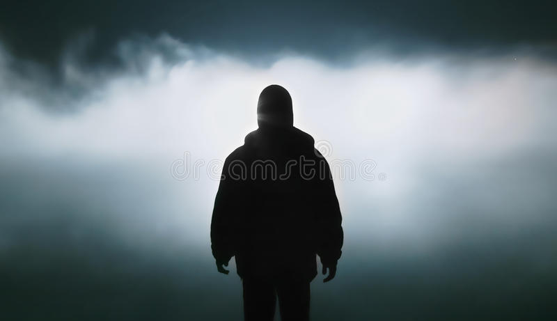 Lantern illuminates the mist over the river, night landscape, male silhouette royalty free stock photo