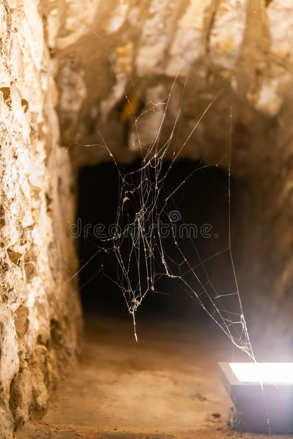 Lantern illuminates the web in the loophole of the fortress in Prague stock images
