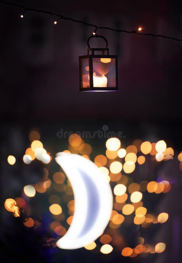 Lantern at night with moon royalty free stock photo