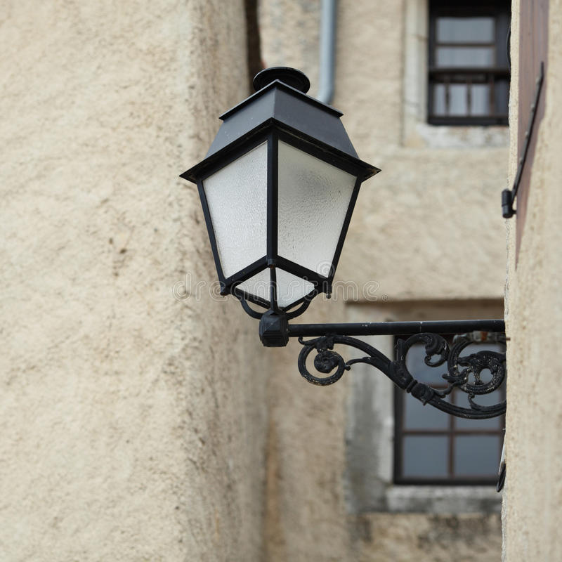 Lantern on wall stock images