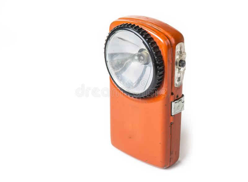 Lanterna elétrica velha da bateria no fundo branco fotografia de stock