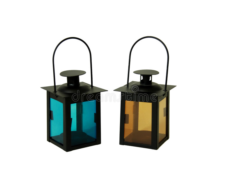 Lanterns. Two bright colored lanterns with handles royalty free stock photo