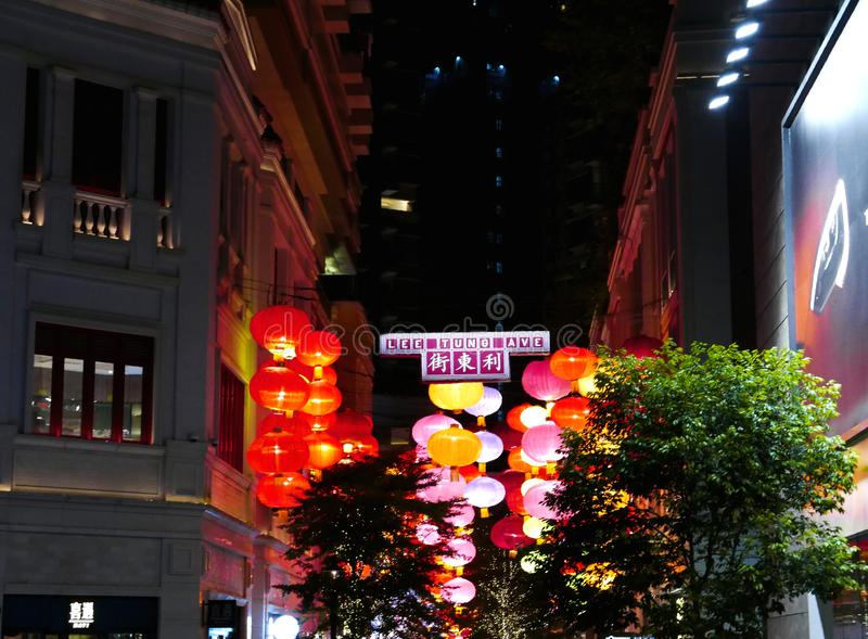 Lanterns hanging on Lee Tung Avenue stock images