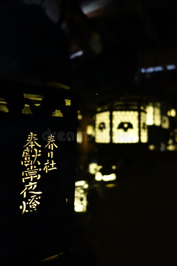 Lanterns lighting in the dark, Kasuga-Taisha Shrine, Nara, Japan royalty free stock photos