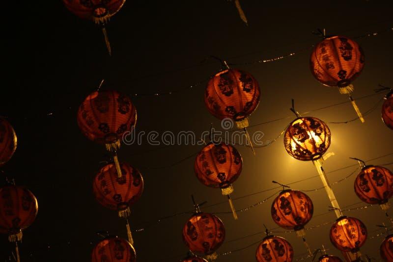 Lanterns for Chinese New Year celebrations. Lanterns for the lunar celebration, with red color and illuminated by night lights, exotic lanterns stock image