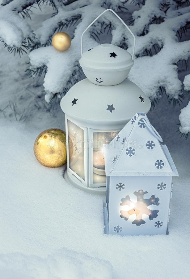 Lanterns outdoors on a Christmas tree under snow royalty free stock photos