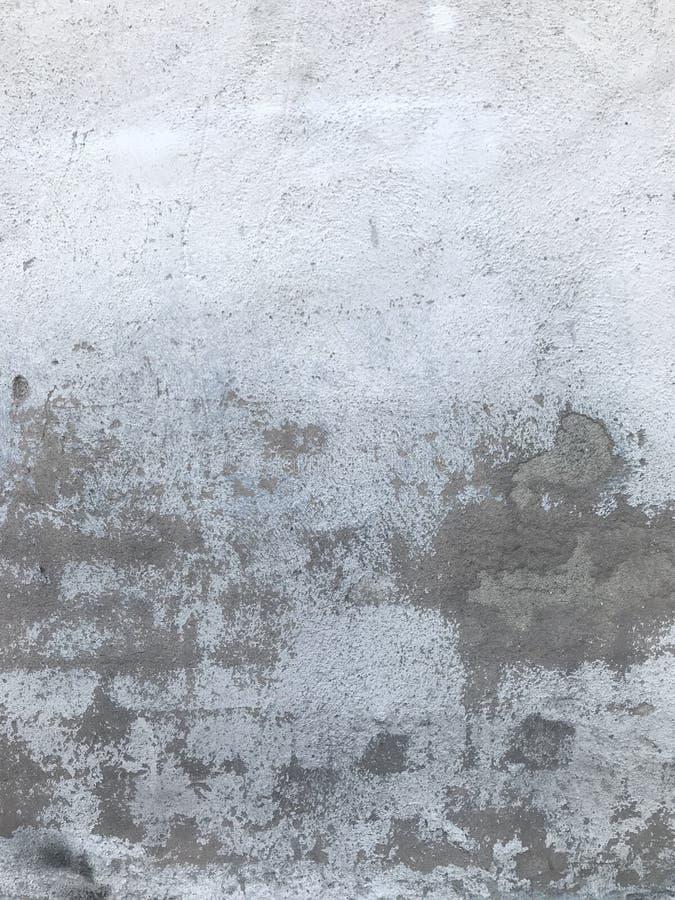 Lantlig grungy stads- textur för bakgrund för stadscementvägg royaltyfria bilder