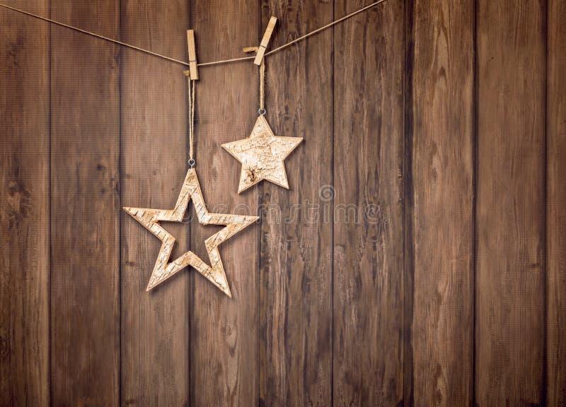Lantlig jul som hänger stjärnabakgrund royaltyfri fotografi