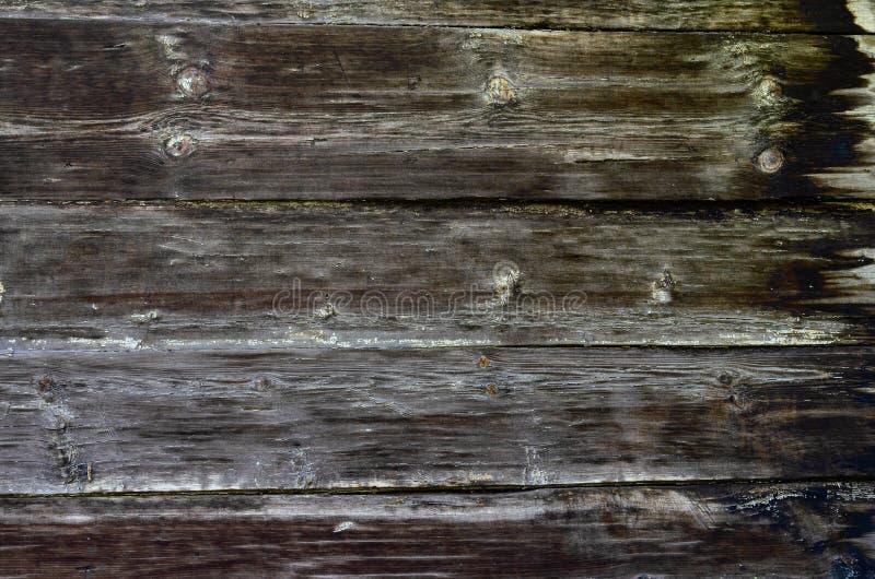 Lantlig mörk träbrädebakgrund eller textur arkivfoto