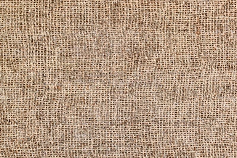 Lantlig textur av säckväv Bakgrund av mycket vävt grovt grovt tyg gjorde av lin, jute eller hampa Material för säckvävpåse Design royaltyfri foto