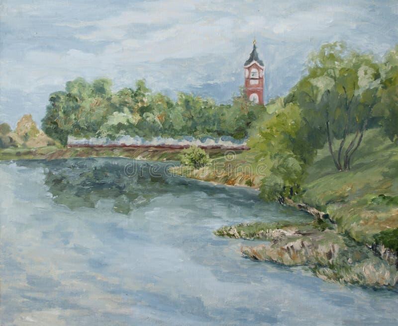 Lantligt landskap med en kyrka på flodbanken royaltyfri fotografi
