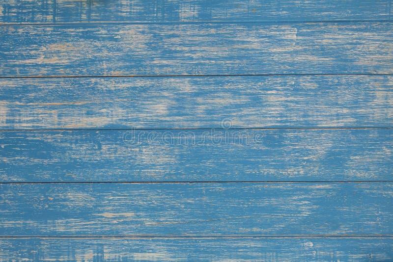 Lantligt trä som textureras med urblekt blå målarfärg för retro och tappningbakgrundsdesign royaltyfri fotografi