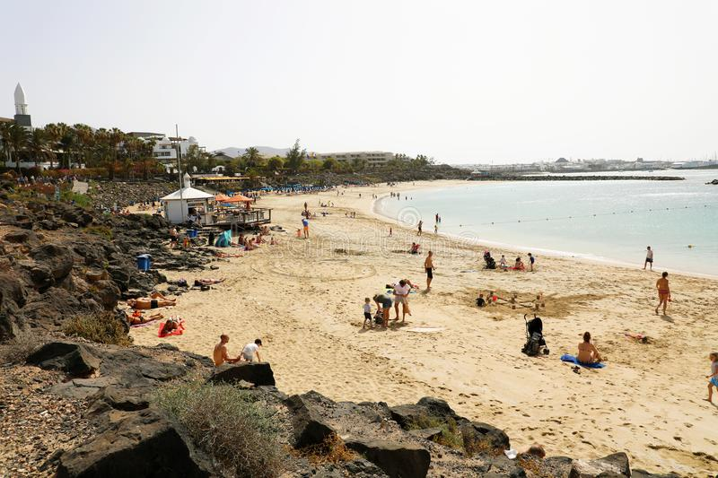 LANZAROTE, SPAIN - APRIL 18, 2018: Beautiful view of Playa Dorada beach with bathers on the sand, Lanzarote, Canary Islands royalty free stock photo