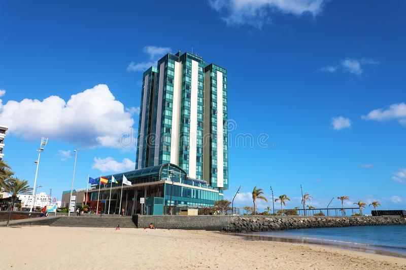 LANZAROTE, SPAIN - APRIL 20, 2018: Five Stars Hotel in Arrecife with beach on blue sky, Lanzarote, Spain stock image
