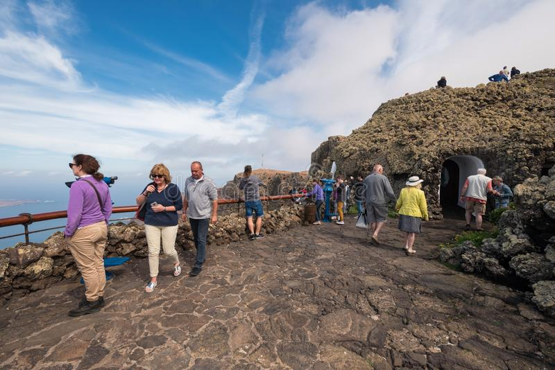 Tourist visiting Mirador del rio famous touristic attraction in Lanzarote, Canary islands, Spain. royalty free stock image