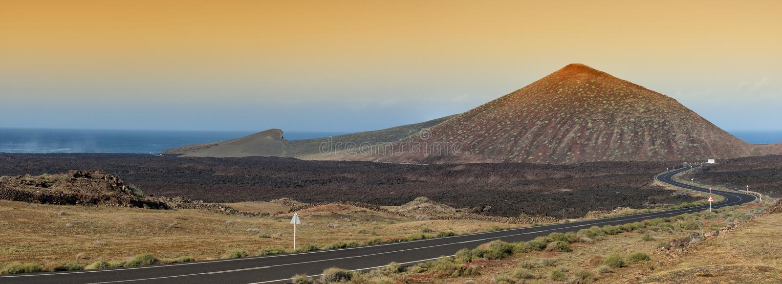 Lanzarote volcanoe, Spain. Volcanic landscape and winding road in Lanzarote, the Canary islands, Spain. Panoramic image