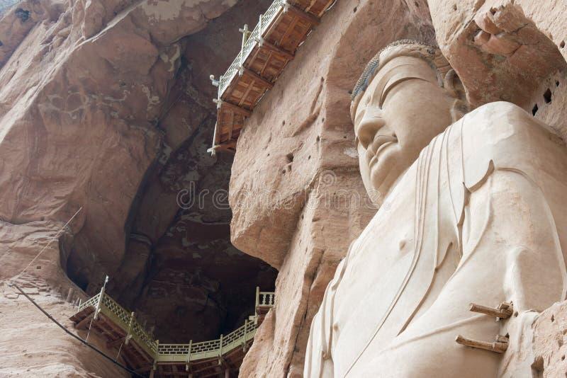 LANZHOU, CHINA - 30 DE SETEMBRO DE 2014: Estátuas da Buda na caverna Te de Bingling imagem de stock