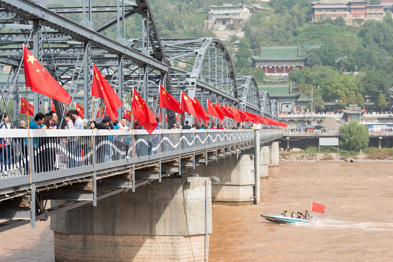 LANZHOU, CHINA - OCT 2 2014: Sun Yat-Sen Bridge (Zhongshan Qiao). a famous First Bridge across the Yellow River in. Lanzhou, Gansu, China royalty free stock image
