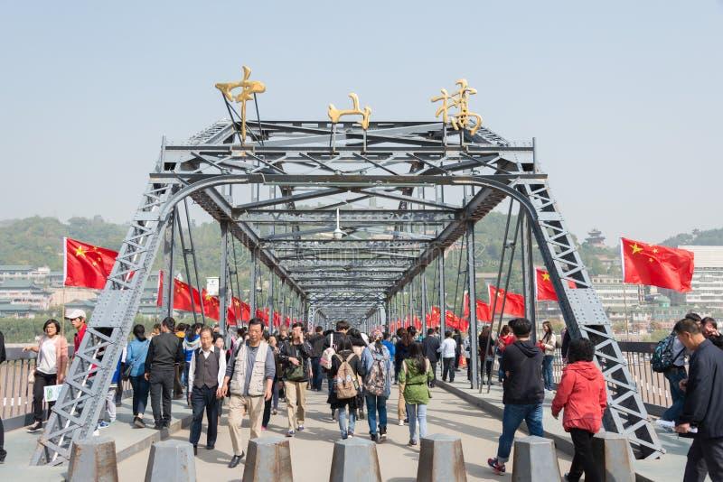 LANZHOU, CHINA - OCT 2 2014: Visitor at Sun Yat-Sen Bridge (Zhongshan Qiao). a famous First Bridge across the Yellow River in Lan. Zhou, Gansu, China stock photo
