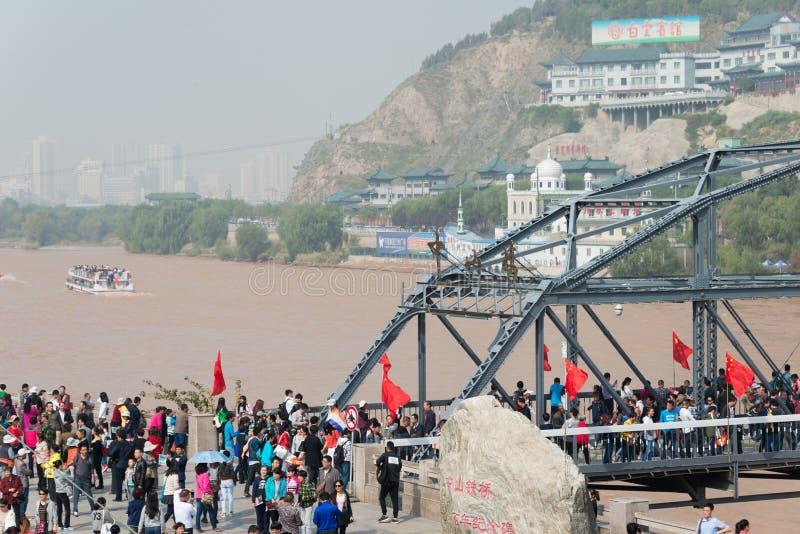 LANZHOU, CHINA - OCT 2 2014: Visitor at Sun Yat-Sen Bridge (Zhongshan Qiao). a famous First Bridge across the Yellow River in Lan. Zhou, Gansu, China stock photography