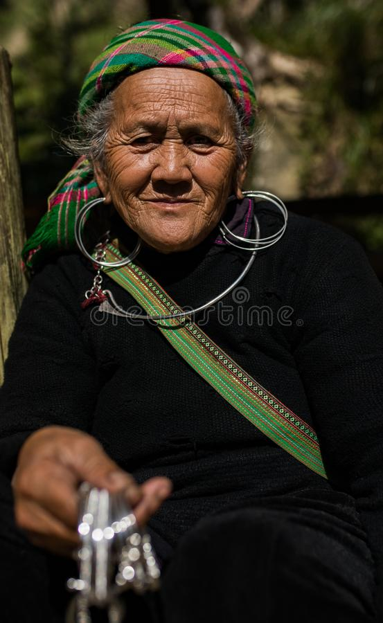 LAO CAI SAPA -VIETNAM - NOV4,2017 : close up face of unidentified old woman of sapa hill tribe selling woman silver accessories stock images