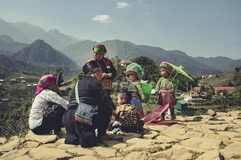 LAO CAI SAPA VIETNAM -NOV4, 2017 : northern vietname hill tribe f. Amily in local village sitting for selling hand made product in sapa town most popular stock images