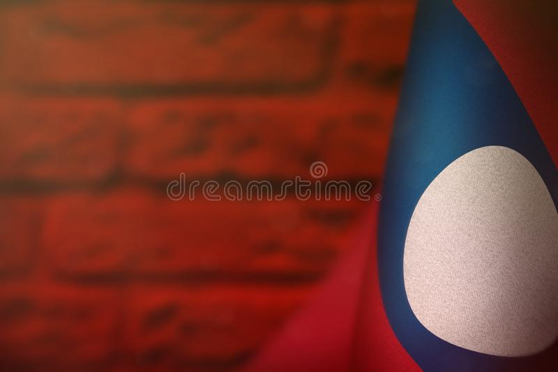 Lao People Democratic Republic flag for honour of veterans day or memorial day. Glory to the Lao People Democratic Republic heroes. Lao People Democratic stock photography
