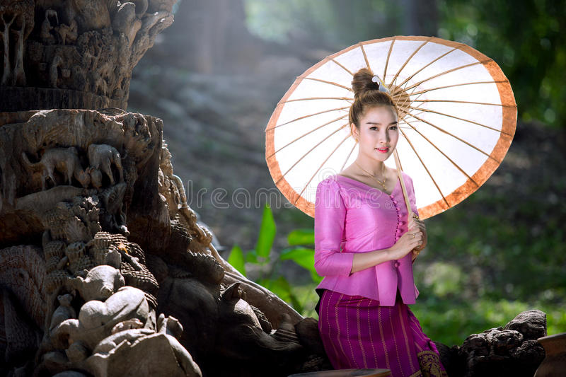 Lao woman in national uniform, Lao woman in national costume holding umbrellas.  royalty free stock photography