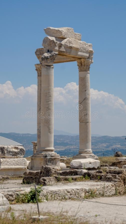 Ancient Greek City Ruins, Laodikeia. Laodikeia is situated in an excellent geographical location on the south side of the Lycus River, 6 km north of Denizli. The royalty free stock images