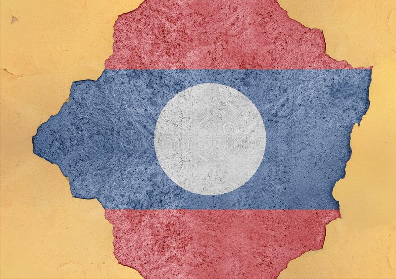 Laos cracked hole and broken flag in big concrete material facade. Structure royalty free stock photo