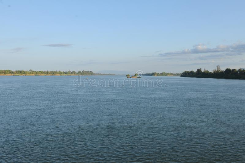 Laos: The Mekong River between Champasak and Pakse City. Is getting wider and wider stock photography