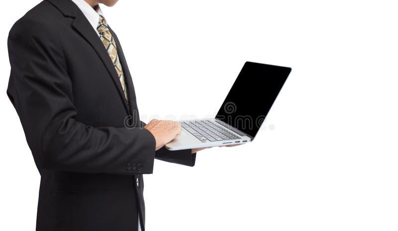 Lap-top εκμετάλλευσης χεριών επιχειρηματιών στην υπεραγορά θαμπάδων στοκ φωτογραφία με δικαίωμα ελεύθερης χρήσης