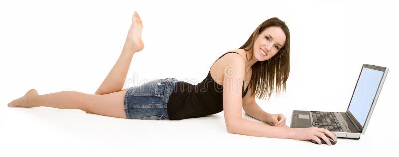 lap-top πατωμάτων που χαμογελά &ch στοκ εικόνες