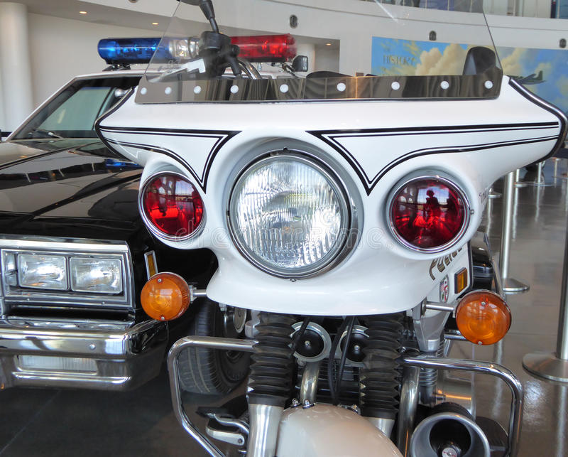 A police motorcycle and police car escort for Ronald Reagans presidential limousine. On display in the Air Force One pavilion at the Ronald Reagan library in stock images