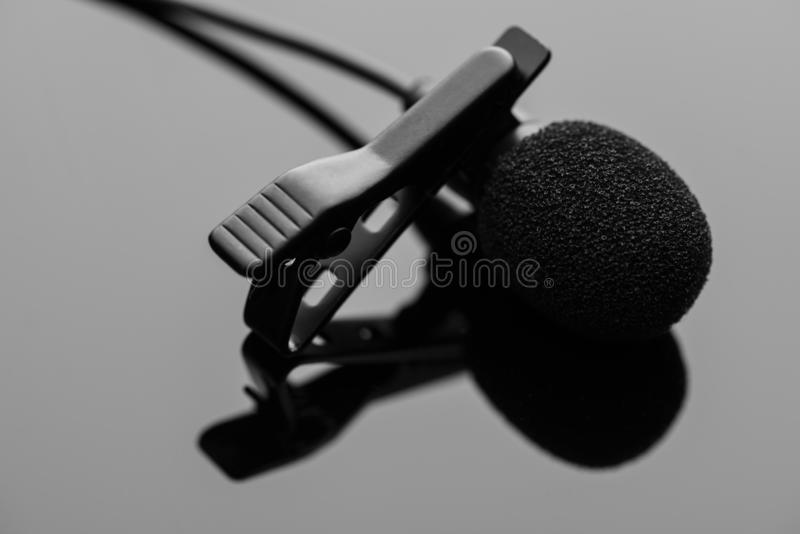 Lapel microphone with a tie-clip royalty free stock photography