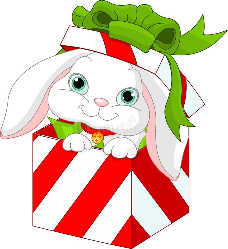 Lapin dans un cadre de cadeau de Noël illustration de vecteur