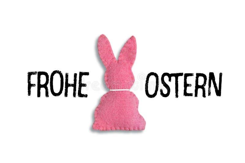 """Lapin de Pâques rose avec le texte """"Frohe Ostern """"sur un fond blanc Traduction : """"Joyeuses Pâques """" photographie stock"""