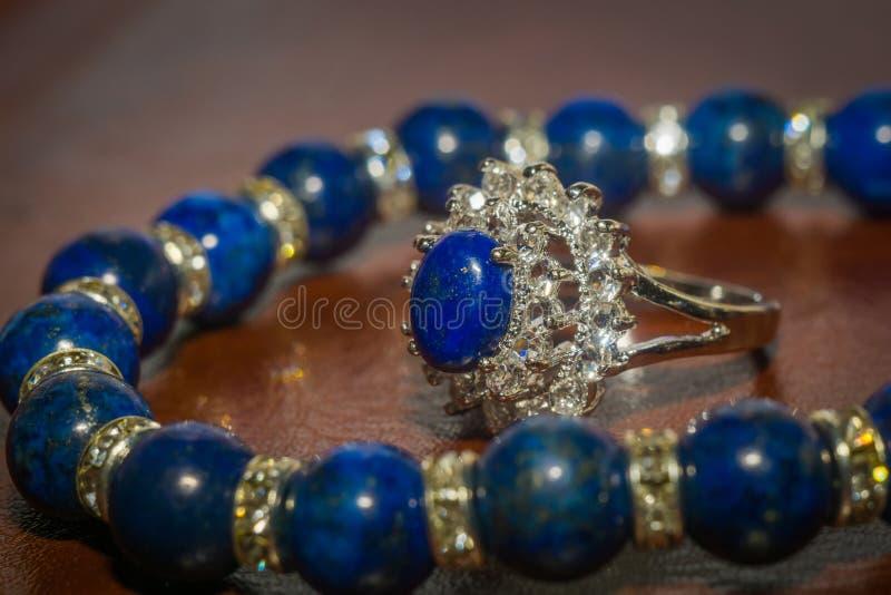Lapis lazuli bracelet. Boho beaded bracelet made of dark blue natural stone, Lapis lazuli macro royalty free stock photography