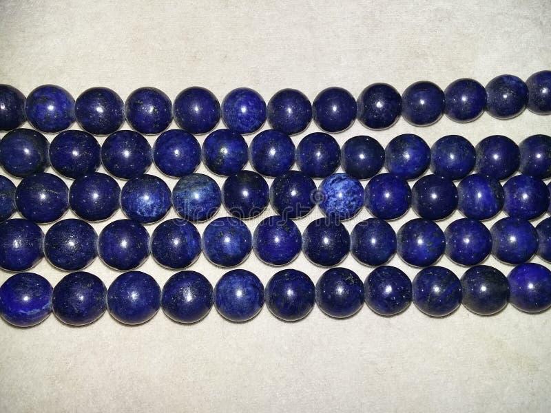 Lapis lazuliparels royalty-vrije stock foto's