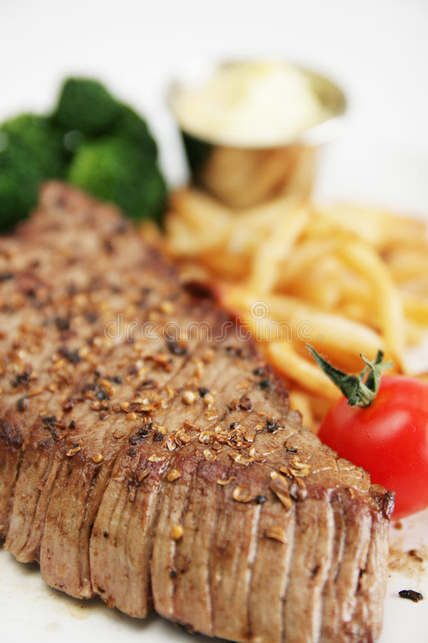 Lapje vlees en frieten stock fotografie