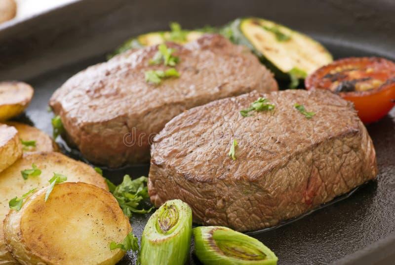 Lapje vlees met Spaanders stock afbeelding