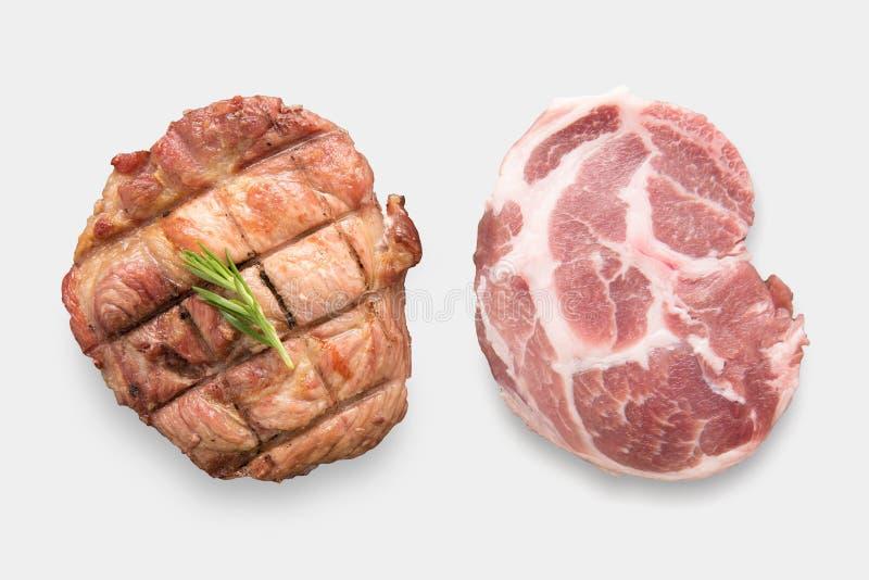Lapje vlees van de model het ruwe varkenskotelet en geroosterde vastgestelde isola van het varkenskoteletlapje vlees stock foto's